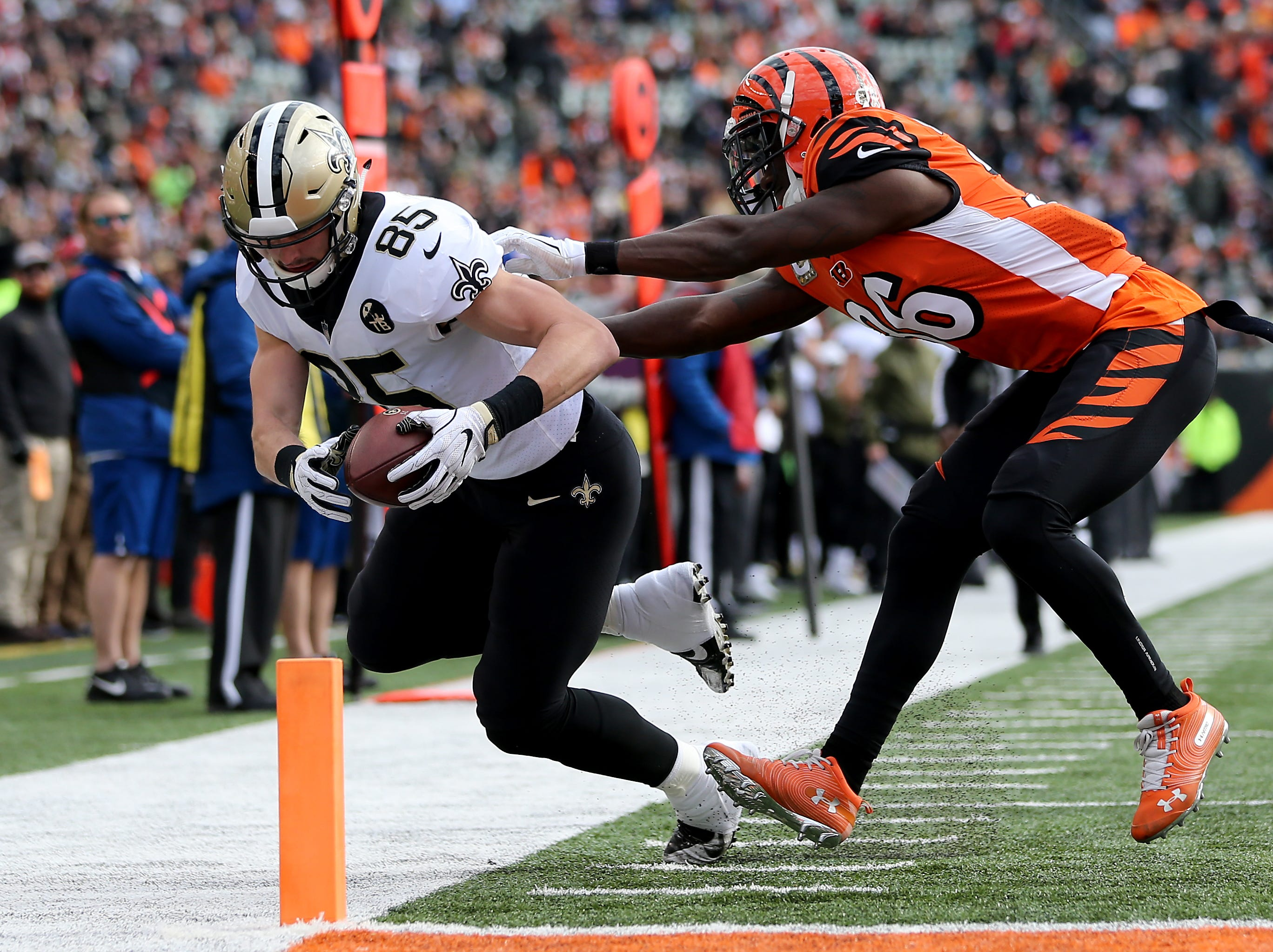 New Orleans Saints tight end Dan Arnold (85) is pushed out of bounds by Cincinnati Bengals strong safety Shawn Williams (36) in the second quarter of a Week 10 NFL game between the New Orleans Saints and the Cincinnati Bengals, Sunday, Nov. 11, 2018, at Paul Brown Stadium in Cincinnati.