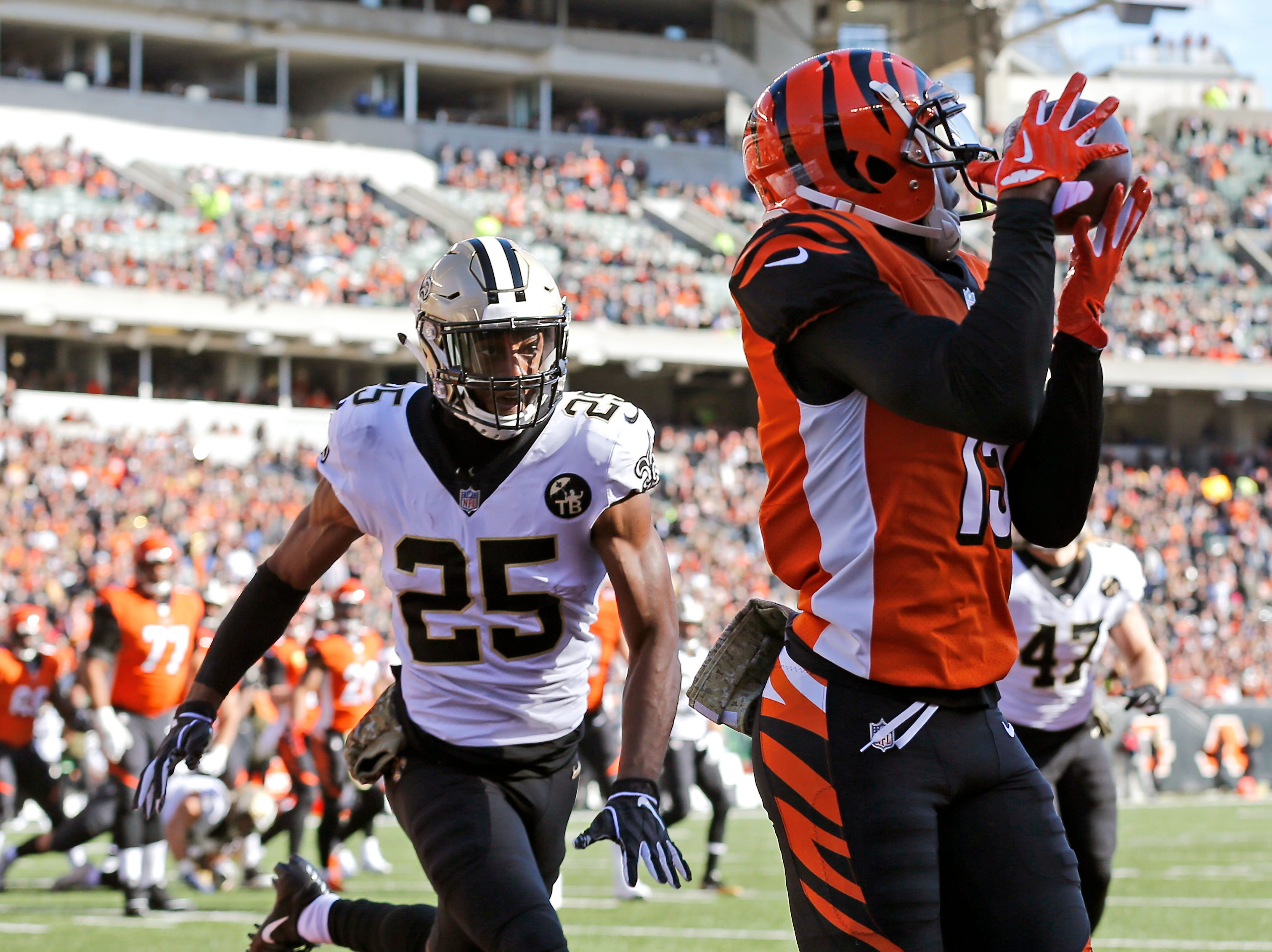 Cincinnati Bengals wide receiver John Ross (15) makes a touchdown catch in the first quarter of the NFL Week 10 game between the Cincinnati Bengals and the New Orleans Saints at Paul Brown Stadium in downtown Cincinnati on Sunday, Nov. 11, 2018. The Saints led 35-7 at halftime.