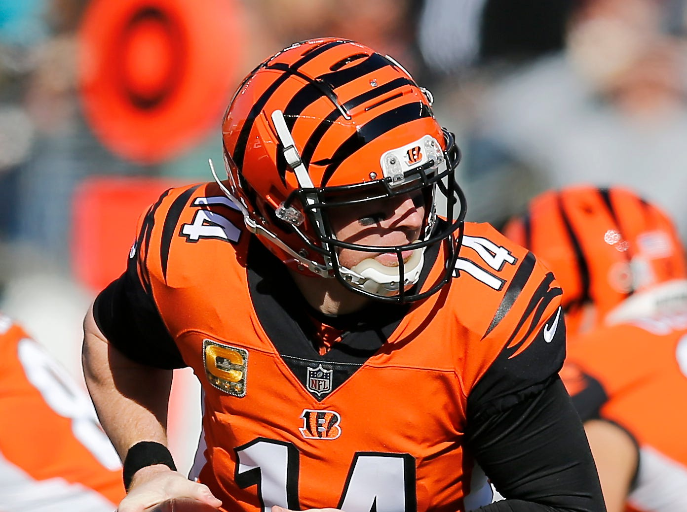 Cincinnati Bengals quarterback Andy Dalton (14) drops back to hand off in the first quarter of the NFL Week 10 game between the Cincinnati Bengals and the New Orleans Saints at Paul Brown Stadium in downtown Cincinnati on Sunday, Nov. 11, 2018. The Saints led 35-7 at halftime.