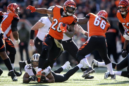 Cincinnati Bengals running back Joe Mixon (28) carries the ball as New Orleans Saints strong safety Vonn Bell (24) defends in the first quarter of a Week 10 NFL game between the New Orleans Saints and the Cincinnati Bengals, Sunday, Nov. 11, 2018, at Paul Brown Stadium in Cincinnati.
