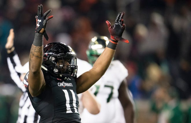 Cincinnati Bearcats linebacker Bryan Wright (11) celebrates after a sack during the NCAA football game between Cincinnati Bearcats and South Florida Bulls on Saturday, Nov. 10, 2018, at Nippert Stadium in Cincinnati.