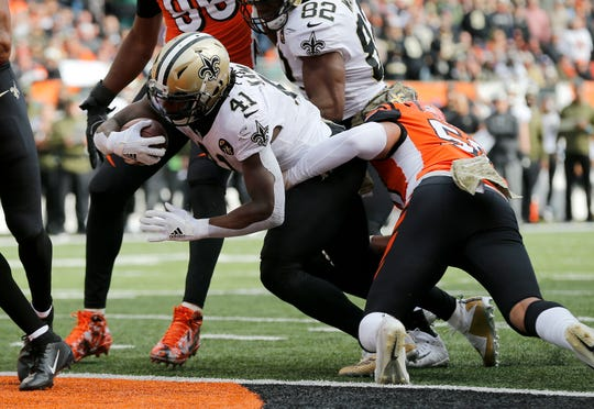 New Orleans Saints running back Alvin Kamara (41) pushes in the the end zone for a touchdown in the second quarter of the NFL Week 10 game between the Cincinnati Bengals and the New Orleans Saints at Paul Brown Stadium in downtown Cincinnati on Sunday, Nov. 11, 2018. The Saints led 35-7 at halftime.