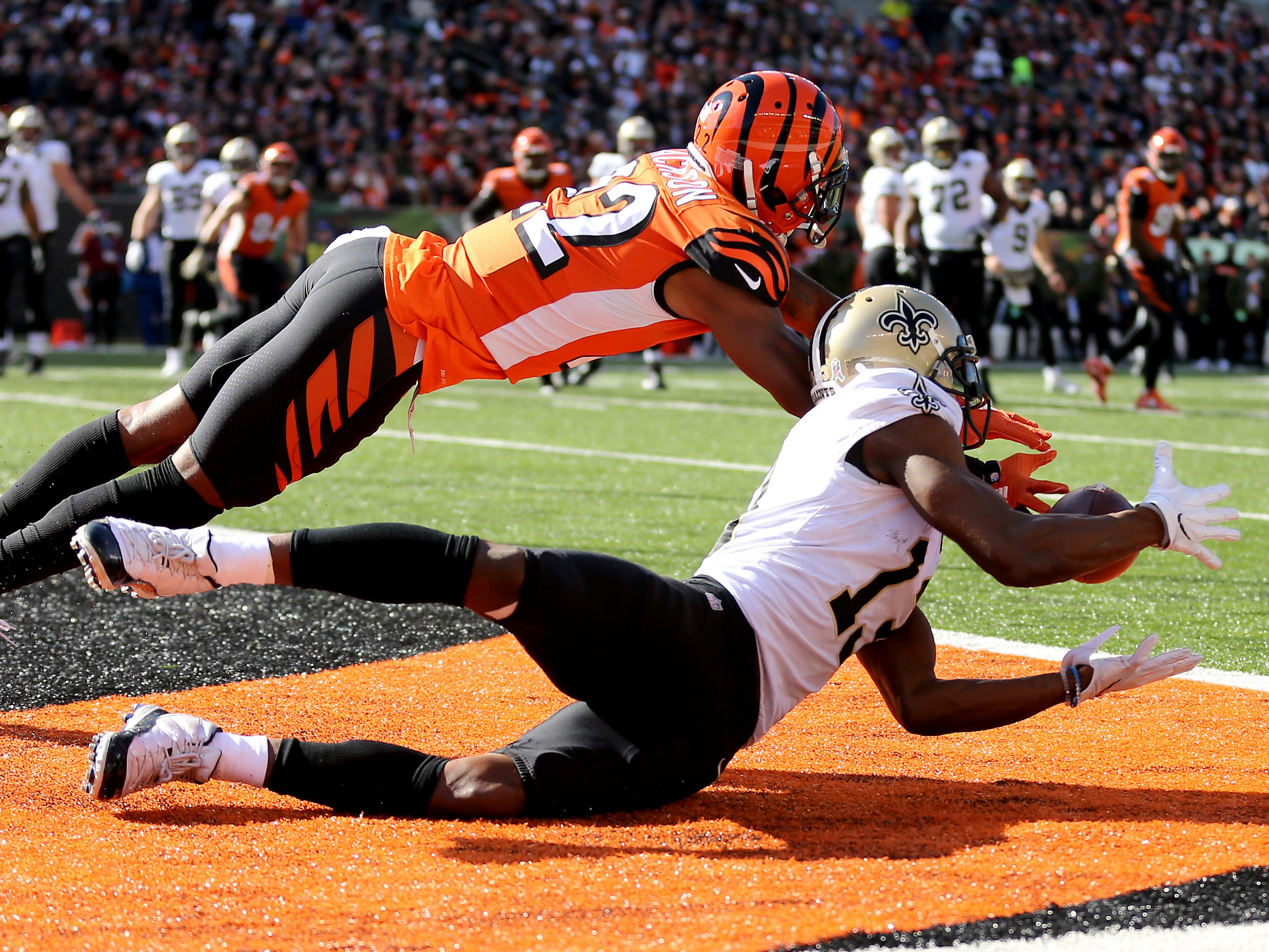 New Orleans Saints wide receiver Michael Thomas (13) catches a touchdown pass as Cincinnati Bengals cornerback William Jackson (22) defends in the first quarter of a Week 10 NFL game between the New Orleans Saints and the Cincinnati Bengals, Sunday, Nov. 11, 2018, at Paul Brown Stadium in Cincinnati.