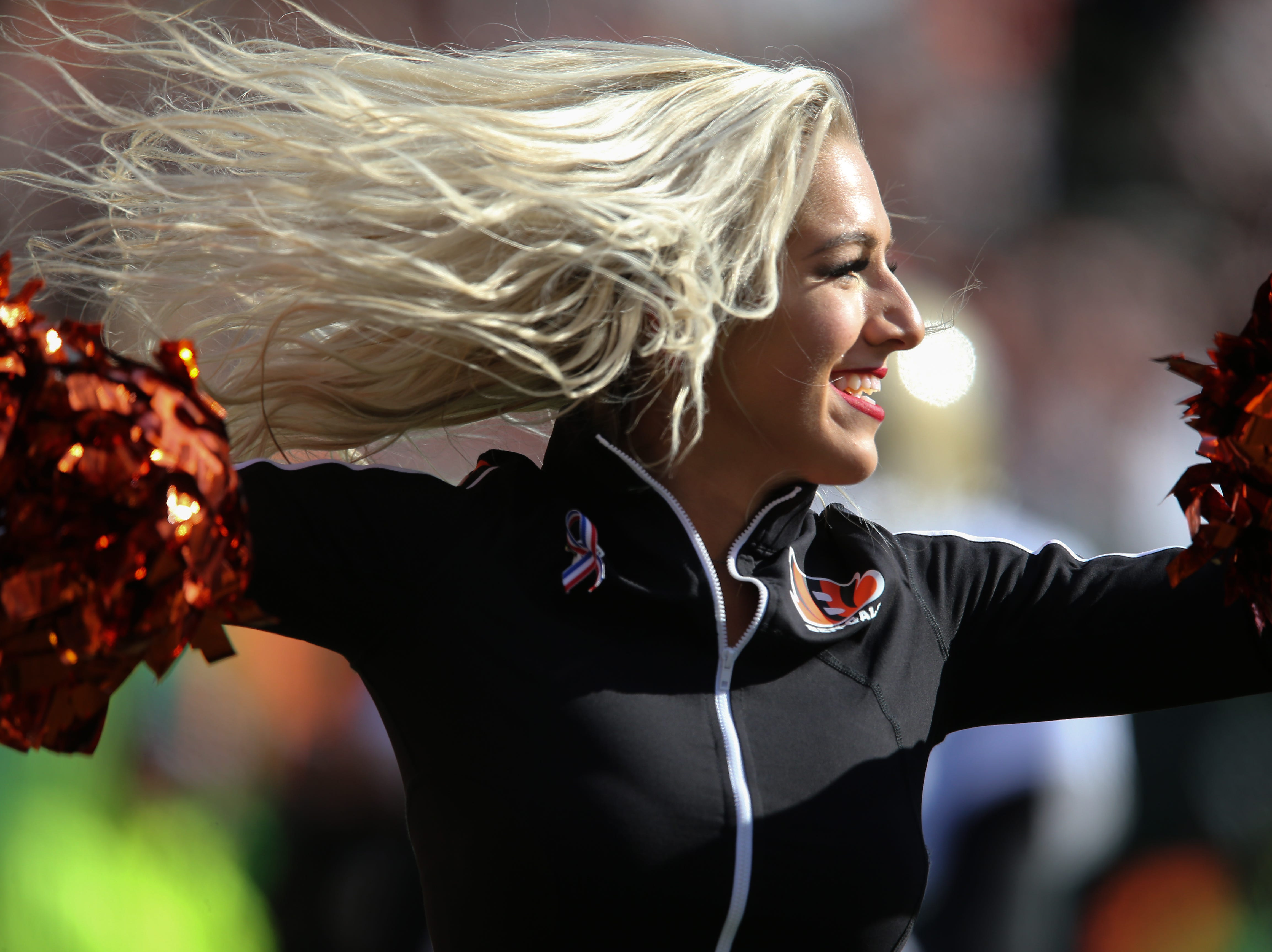 A Cincinnati Bengals Ben-Gal cheerleader performs in the first quarter of a Week 10 NFL game between the New Orleans Saints and the Cincinnati Bengals, Sunday, Nov. 11, 2018, at Paul Brown Stadium in Cincinnati.