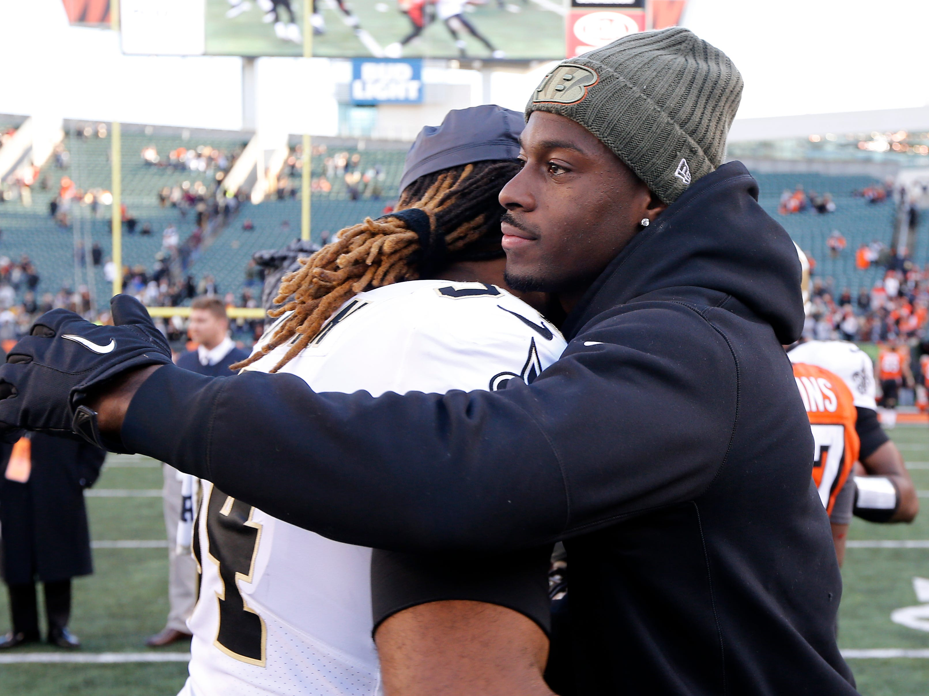 New Orleans Saints defensive end Cameron Jordan (94) hugs injured Cincinnati Bengals wide receiver A.J. Green (18) after the NFL Week 10 game between the Cincinnati Bengals and the New Orleans Saints at Paul Brown Stadium in downtown Cincinnati on Sunday, Nov. 11, 2018. The Saints beat the Bengals 51-14.
