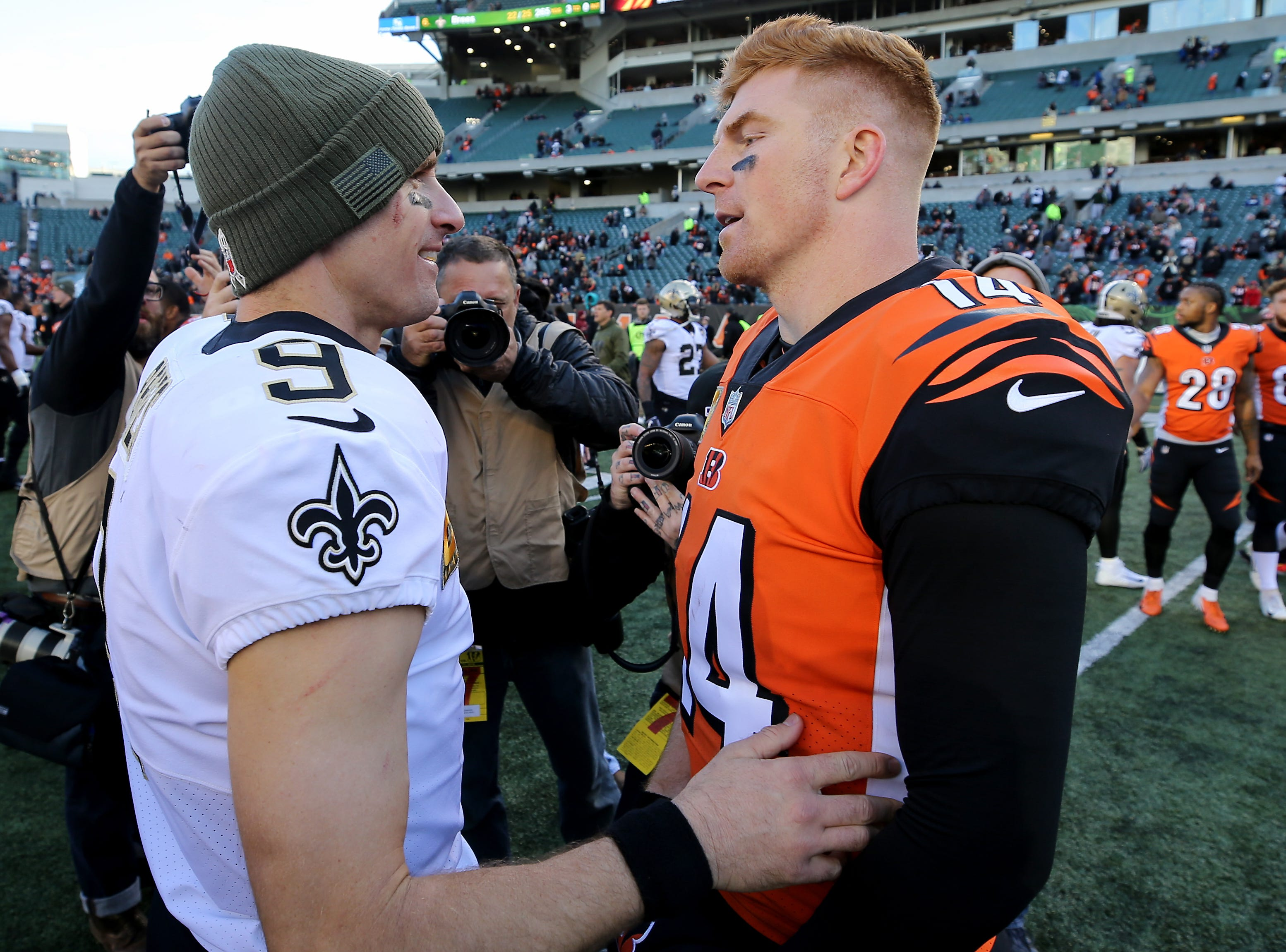 New Orleans Saints quarterback Drew Brees (9), left, and Cincinnati Bengals quarterback Andy Dalton (14) shake hands at the end of the Week 10 NFL game between the New Orleans Saints and the Cincinnati Bengals, Sunday, Nov. 11, 2018, at Paul Brown Stadium in Cincinnati. The New Orleans Saints won 51-14.