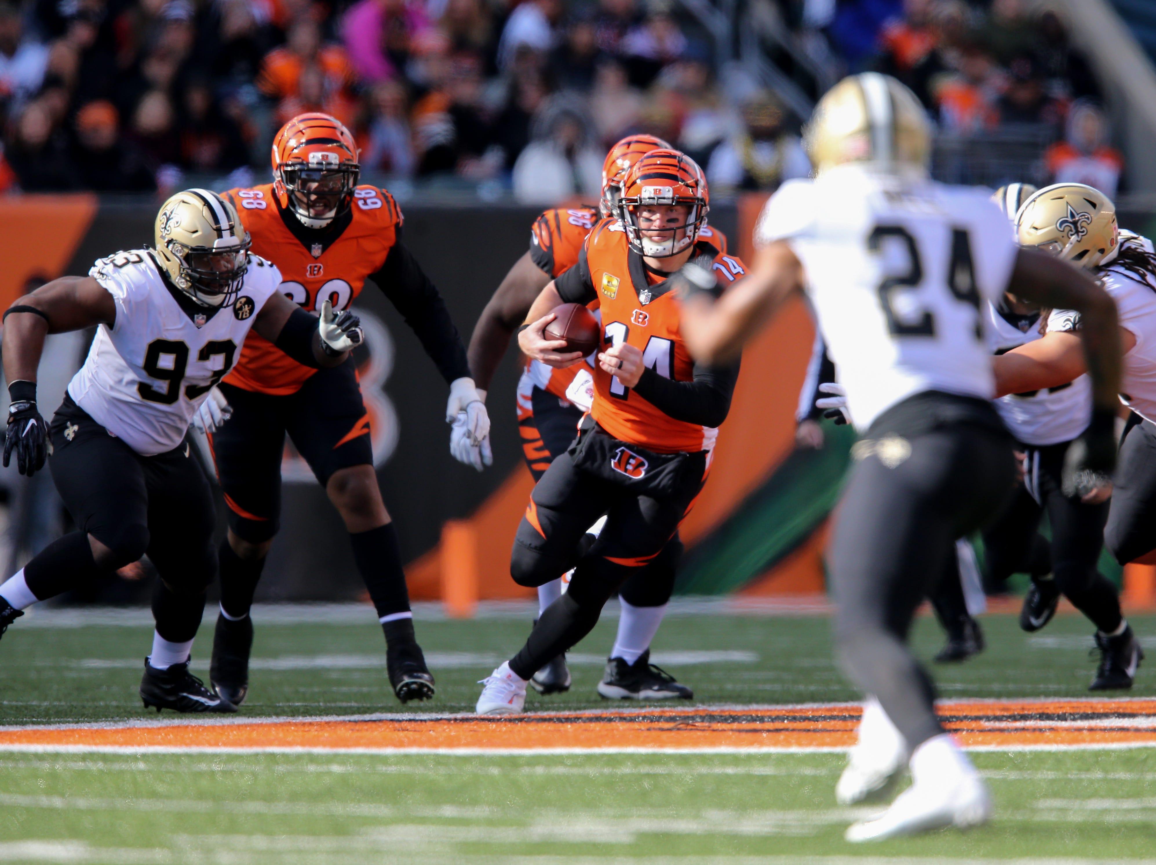 Cincinnati Bengals quarterback Andy Dalton (14) runs out of the pocket in the second quarter of a Week 10 NFL game between the New Orleans Saints and the Cincinnati Bengals, Sunday, Nov. 11, 2018, at Paul Brown Stadium in Cincinnati.