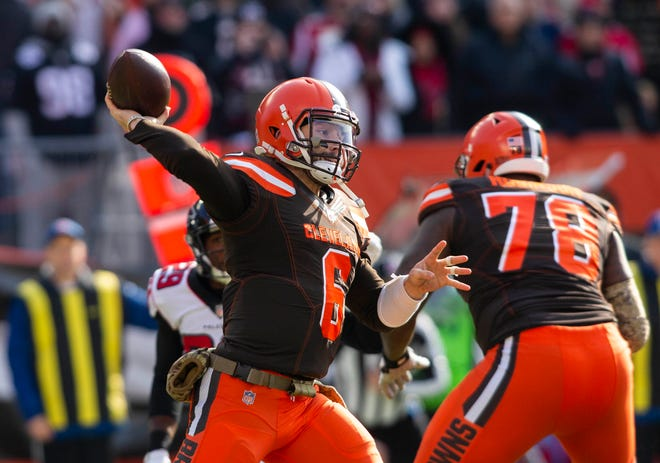 Nov 11, 2018; Cleveland, OH, USA; Cleveland Browns quarterback Baker Mayfield (6) completes a pass against the Atlanta Falcons during the first quarter at FirstEnergy Stadium. Mandatory Credit: Scott R. Galvin-USA TODAY Sports