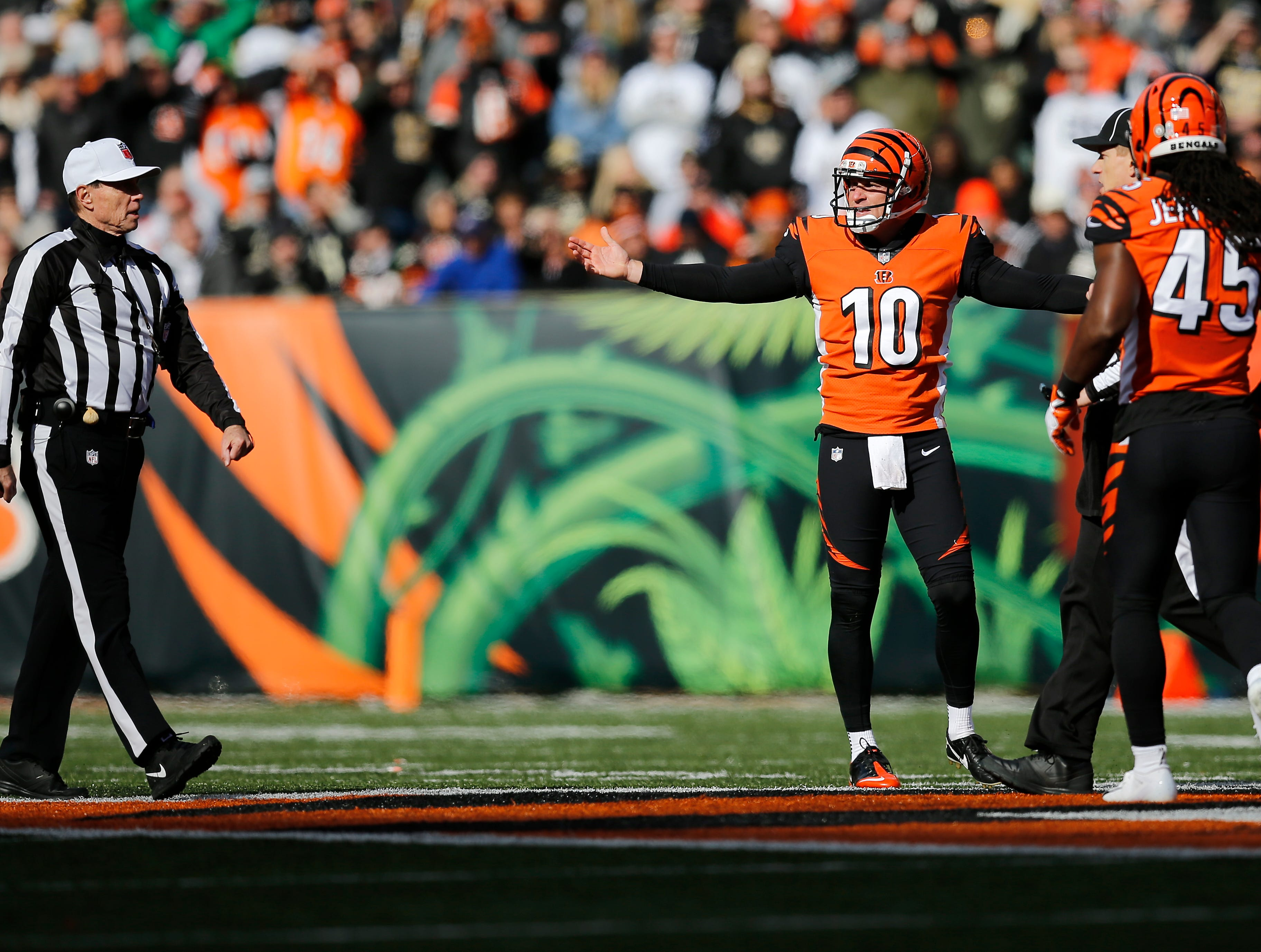 Cincinnati Bengals punter Kevin Huber (10) appeals to an official for a penalty after being hit on a punt in the second quarter of the NFL Week 10 game between the Cincinnati Bengals and the New Orleans Saints at Paul Brown Stadium in downtown Cincinnati on Sunday, Nov. 11, 2018. The Saints led 35-7 at halftime.