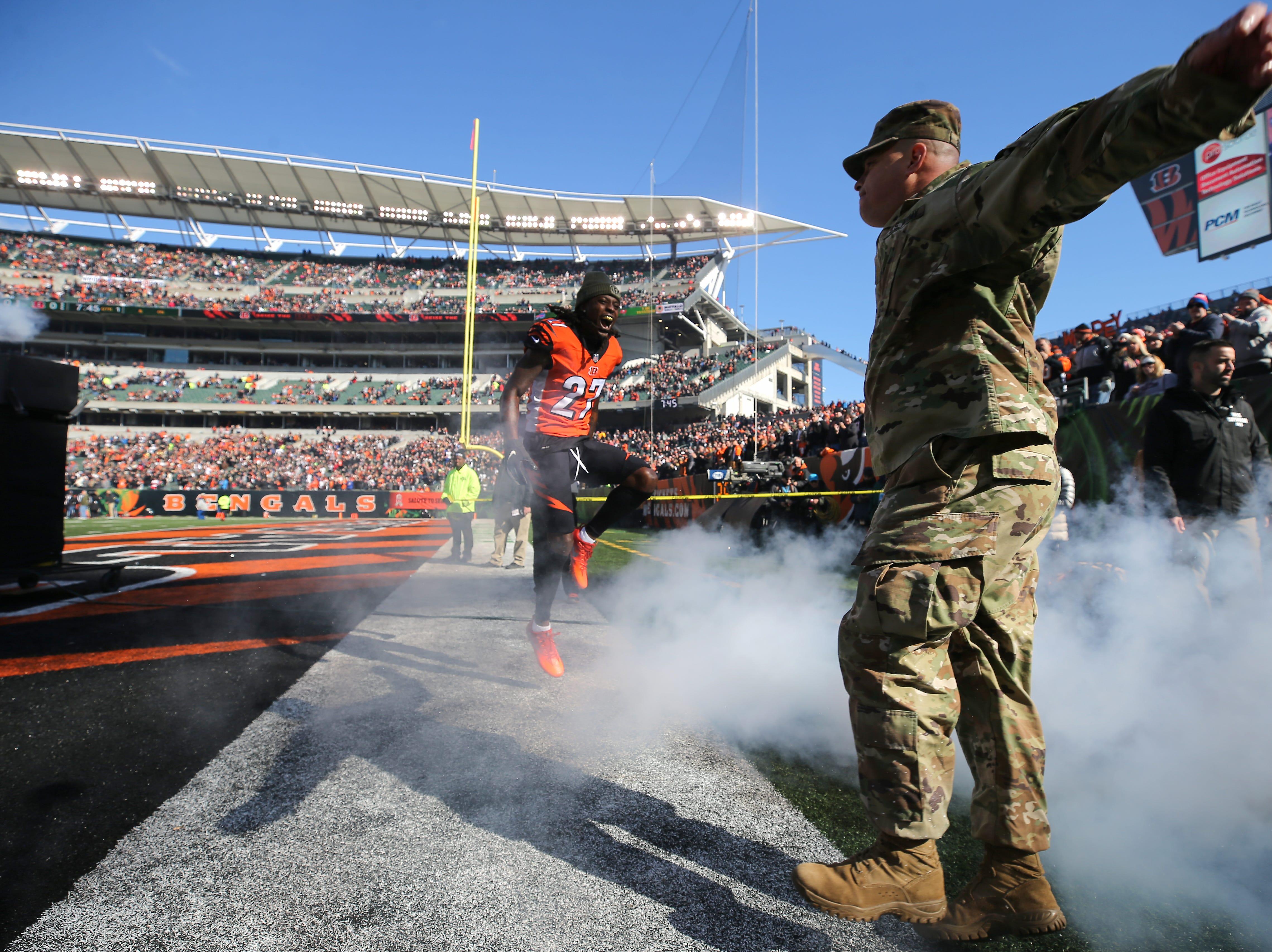 U.S. Army Major Jason Roberts, right , is introduced with Cincinnati Bengals cornerback Dre Kirkpatrick (27) before the Week 10 NFL game between the New Orleans Saints and the Cincinnati Bengals, Sunday, Nov. 11, 2018, at Paul Brown Stadium in Cincinnati.