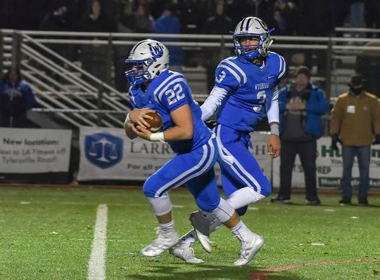 Pierson Rogers of Wyoming  takes a handoff from Evan Prater  against Indian Hill in the OHSAA D4 Region 16 Playoffs at Lakota West High School, Saturday, Nov. 10, 2018