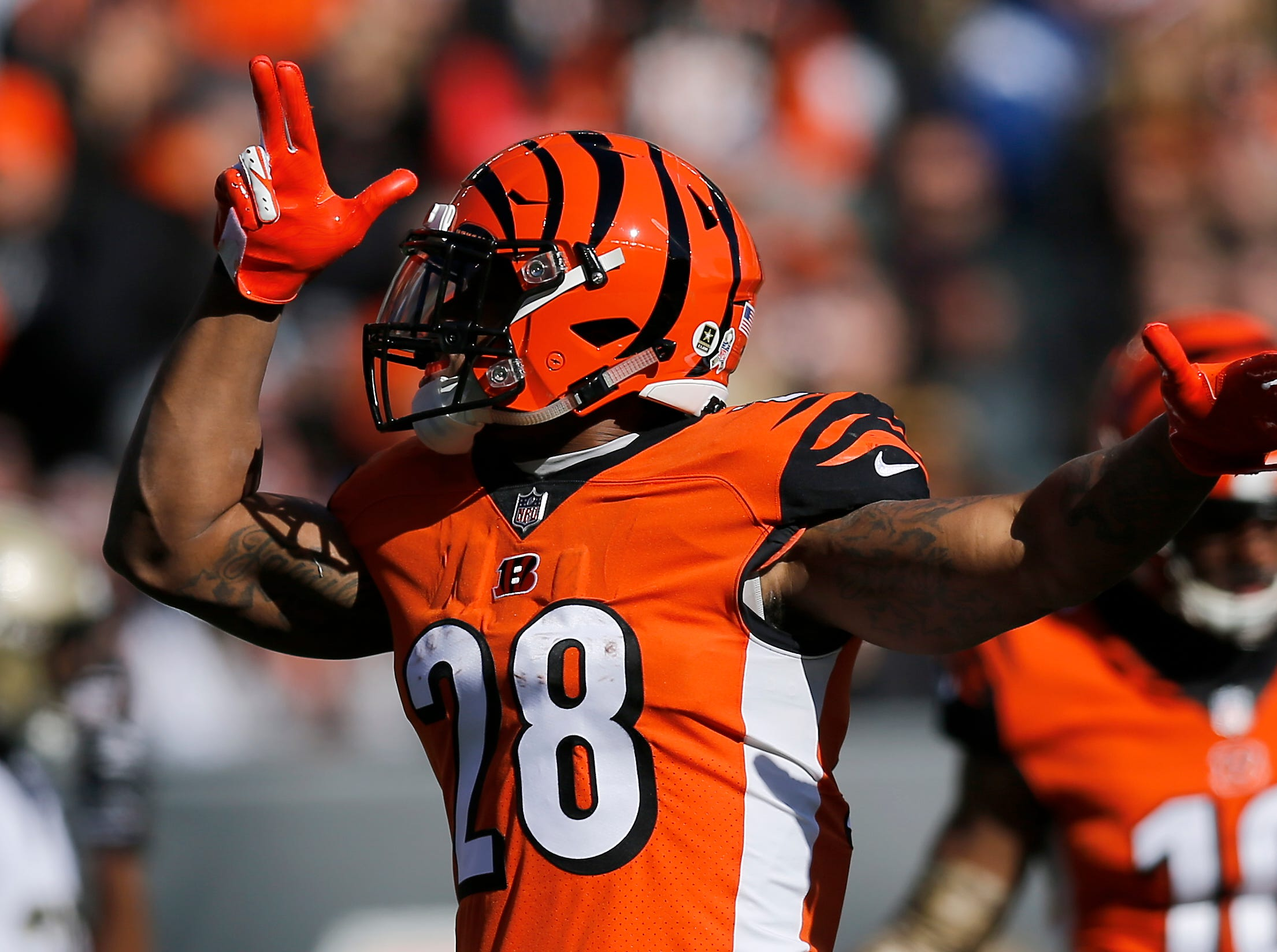 Cincinnati Bengals running back Joe Mixon (28) celebrates after running for a first down in the first quarter of the NFL Week 10 game between the Cincinnati Bengals and the New Orleans Saints at Paul Brown Stadium in downtown Cincinnati on Sunday, Nov. 11, 2018. The Saints led 35-7 at halftime.