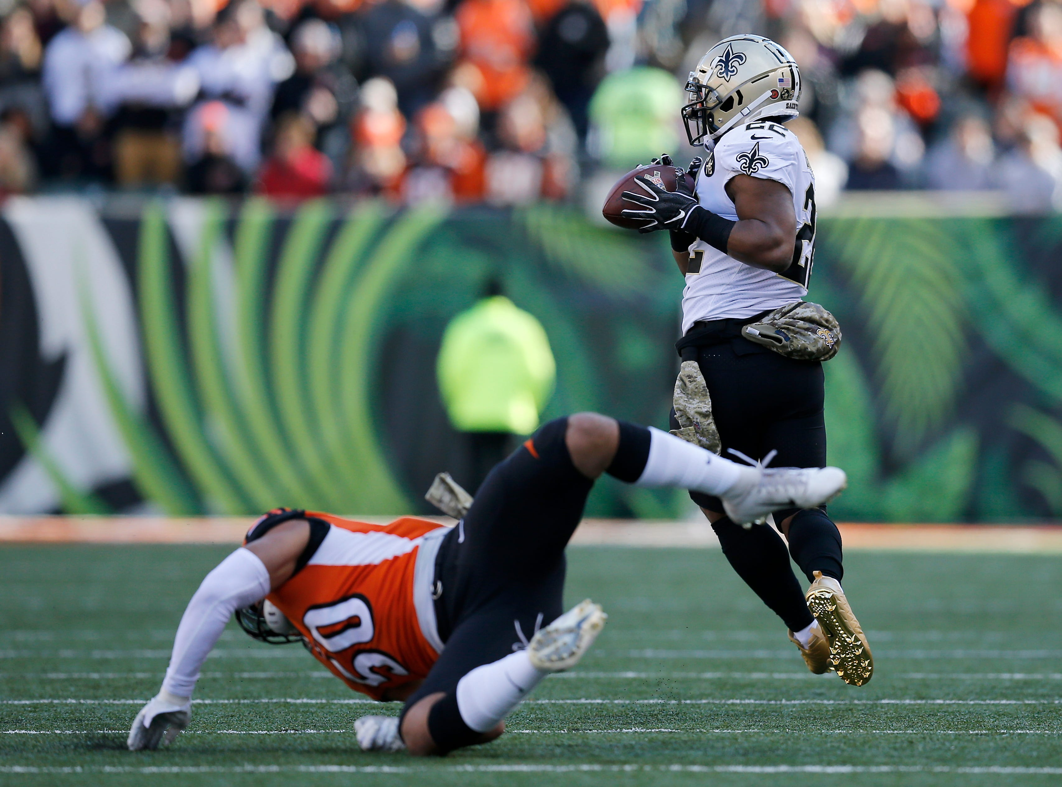 New Orleans Saints running back Mark Ingram (22) makes a catch over Cincinnati Bengals outside linebacker Jordan Evans (50) in the first quarter of the NFL Week 10 game between the Cincinnati Bengals and the New Orleans Saints at Paul Brown Stadium in downtown Cincinnati on Sunday, Nov. 11, 2018. The Saints led 35-7 at halftime.