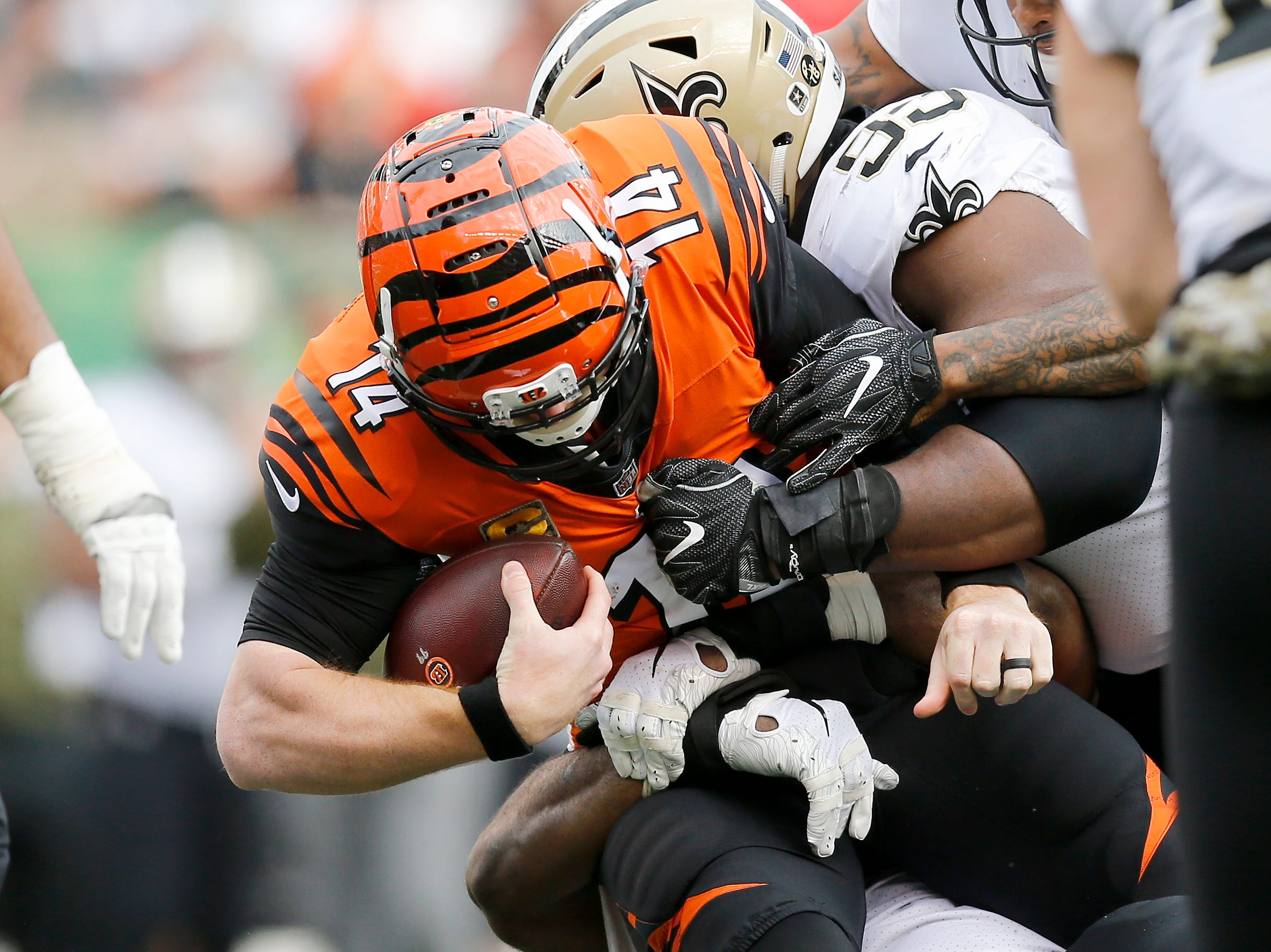 Cincinnati Bengals quarterback Andy Dalton (14) is sacked in the second quarter of the NFL Week 10 game between the Cincinnati Bengals and the New Orleans Saints at Paul Brown Stadium in downtown Cincinnati on Sunday, Nov. 11, 2018. The Saints led 35-7 at halftime.