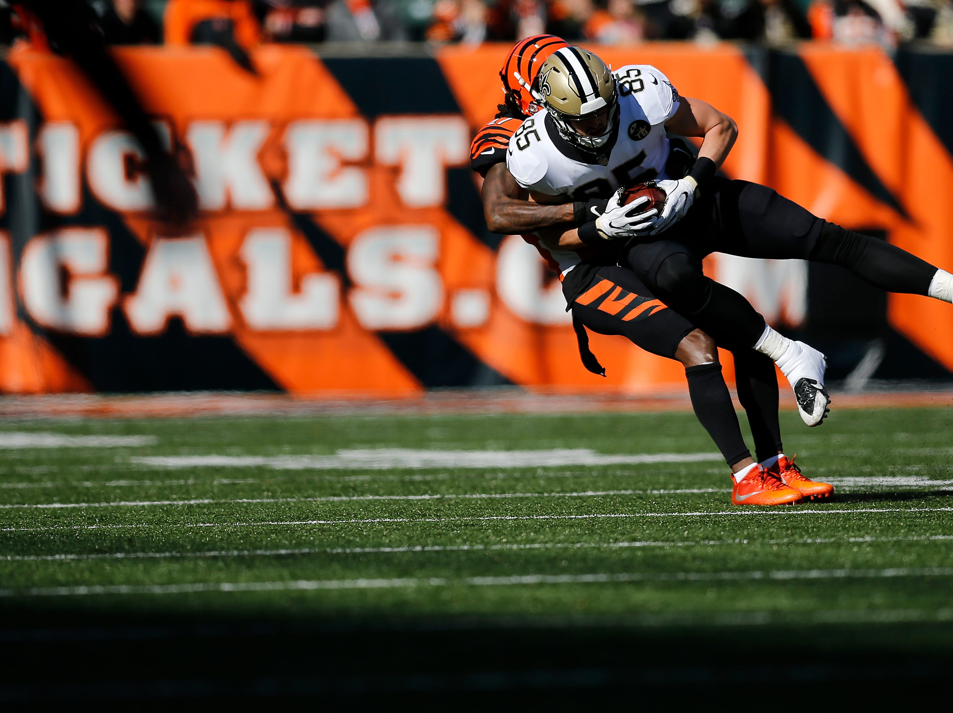 Cincinnati Bengals cornerback Dre Kirkpatrick (27) pulls down New Orleans Saints tight end Dan Arnold (85) after a catch in the first quarter of the NFL Week 10 game between the Cincinnati Bengals and the New Orleans Saints at Paul Brown Stadium in downtown Cincinnati on Sunday, Nov. 11, 2018. The Saints led 35-7 at halftime.