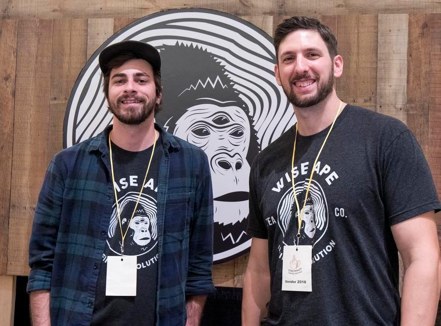 Joe Scola and Chris Blatt of Wise Ape Tea Co. hand out samples during the Cincinnati Coffee Festival at Music Hall Saturday, November 10, 2018 in Cincinnati, Ohio.