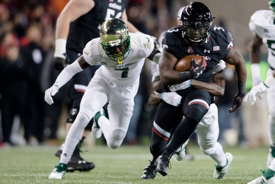 Cincinnati Bearcats running back Michael Warren II (3) runs downfield during the NCAA football game between Cincinnati Bearcats and South Florida Bulls on Saturday, Nov. 10, 2018, at Nippert Stadium in Cincinnati.