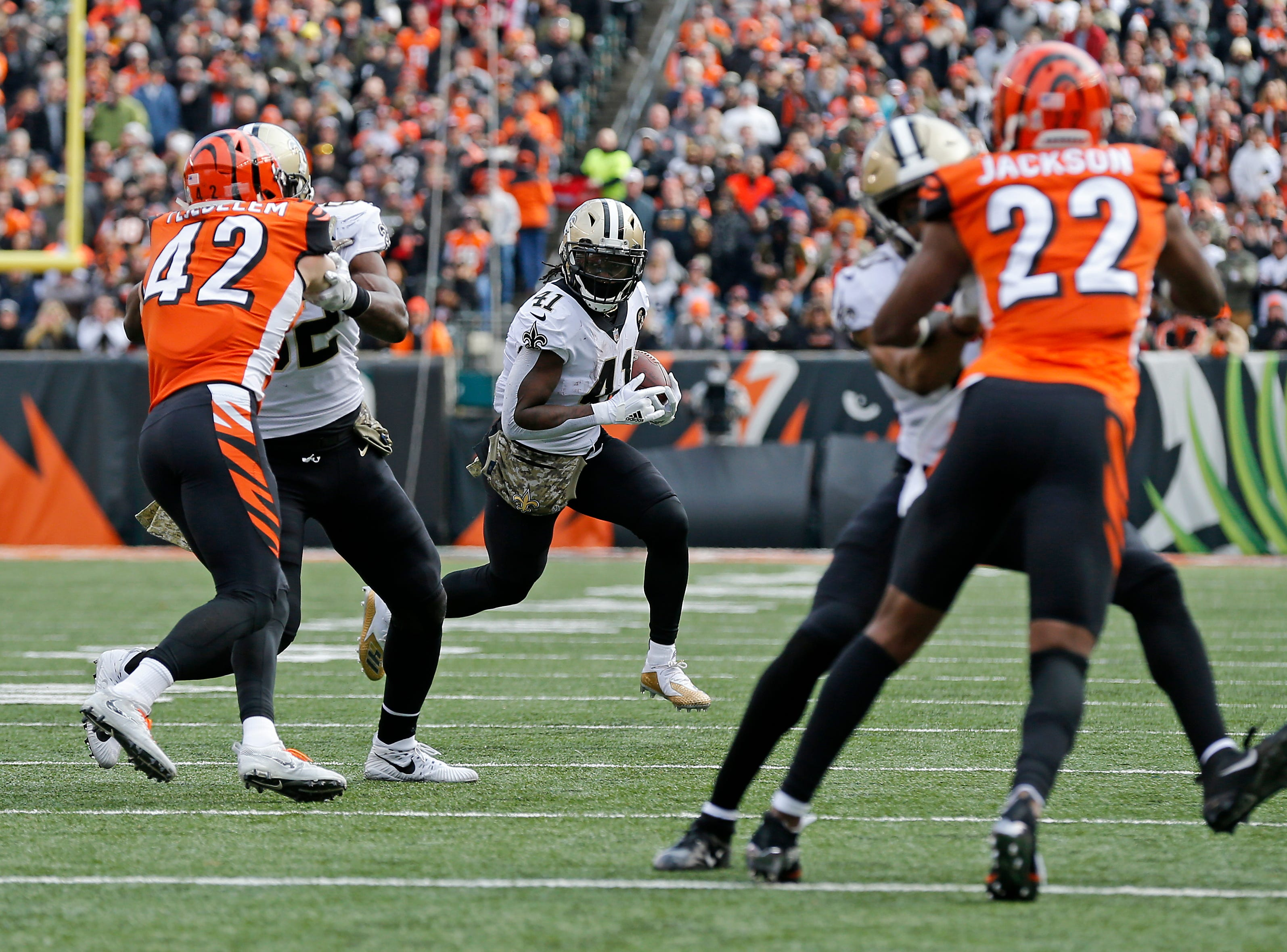 New Orleans Saints running back Alvin Kamara (41) looks for a hole as he makes a carry in the second quarter of the NFL Week 10 game between the Cincinnati Bengals and the New Orleans Saints at Paul Brown Stadium in downtown Cincinnati on Sunday, Nov. 11, 2018. The Saints led 35-7 at halftime.