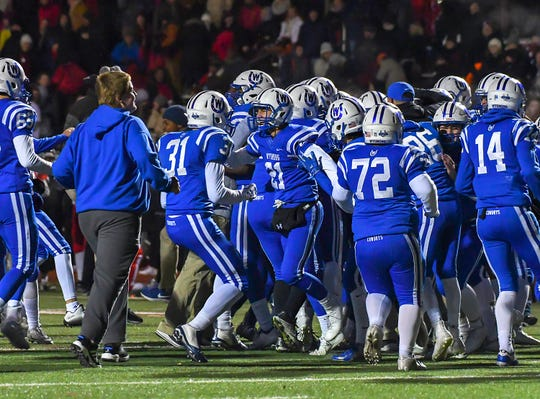 Wyoming players celebrate in overtime after beating Indian Hill in the OHSAA D4 Region 16 Playoffs at Lakota West High School, Saturday, Nov. 10, 2018