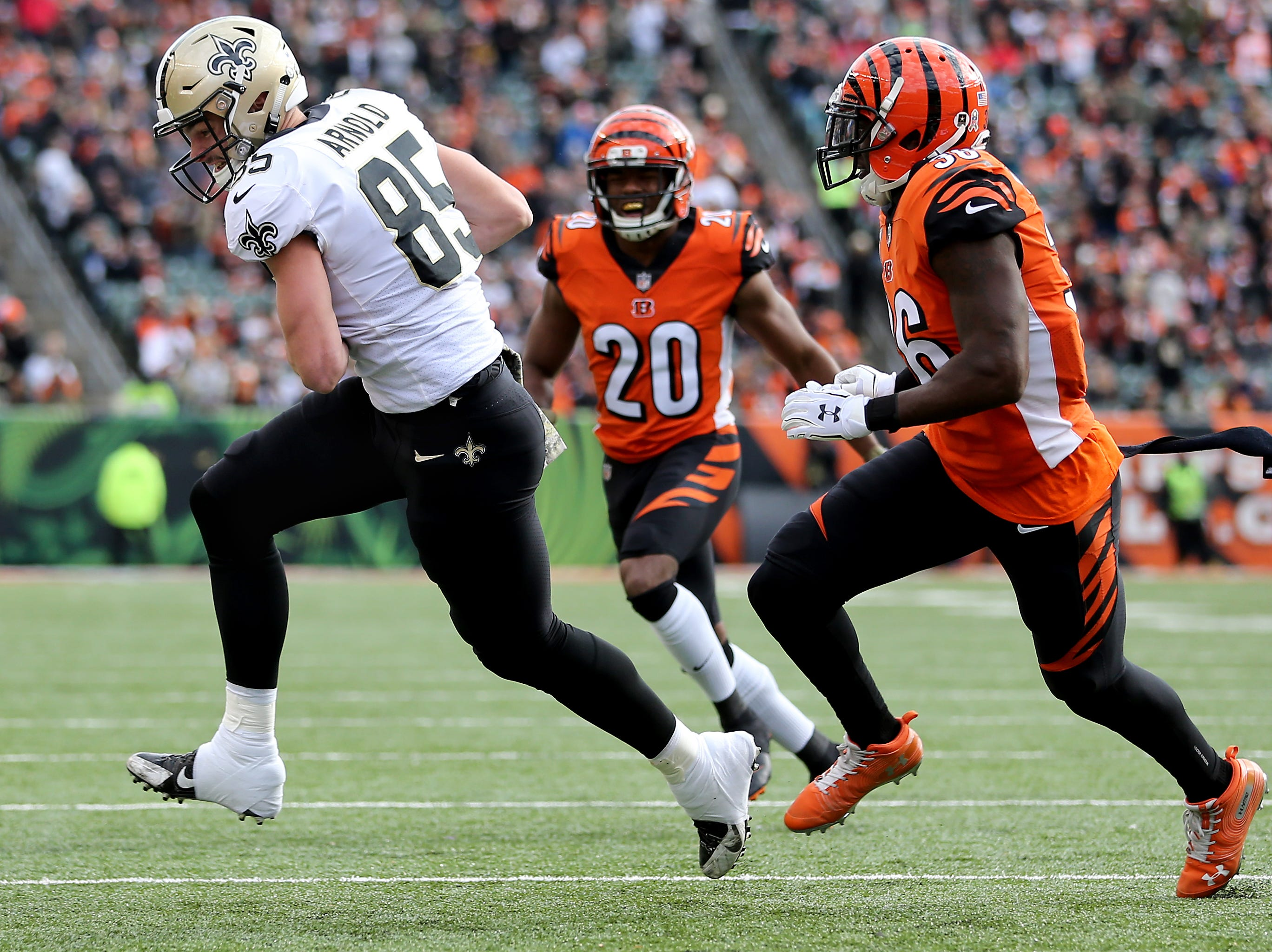 New Orleans Saints tight end Dan Arnold (85) completes a reception as Cincinnati Bengals strong safety Shawn Williams (36) in the second quarter of a Week 10 NFL game between the New Orleans Saints and the Cincinnati Bengals, Sunday, Nov. 11, 2018, at Paul Brown Stadium in Cincinnati.