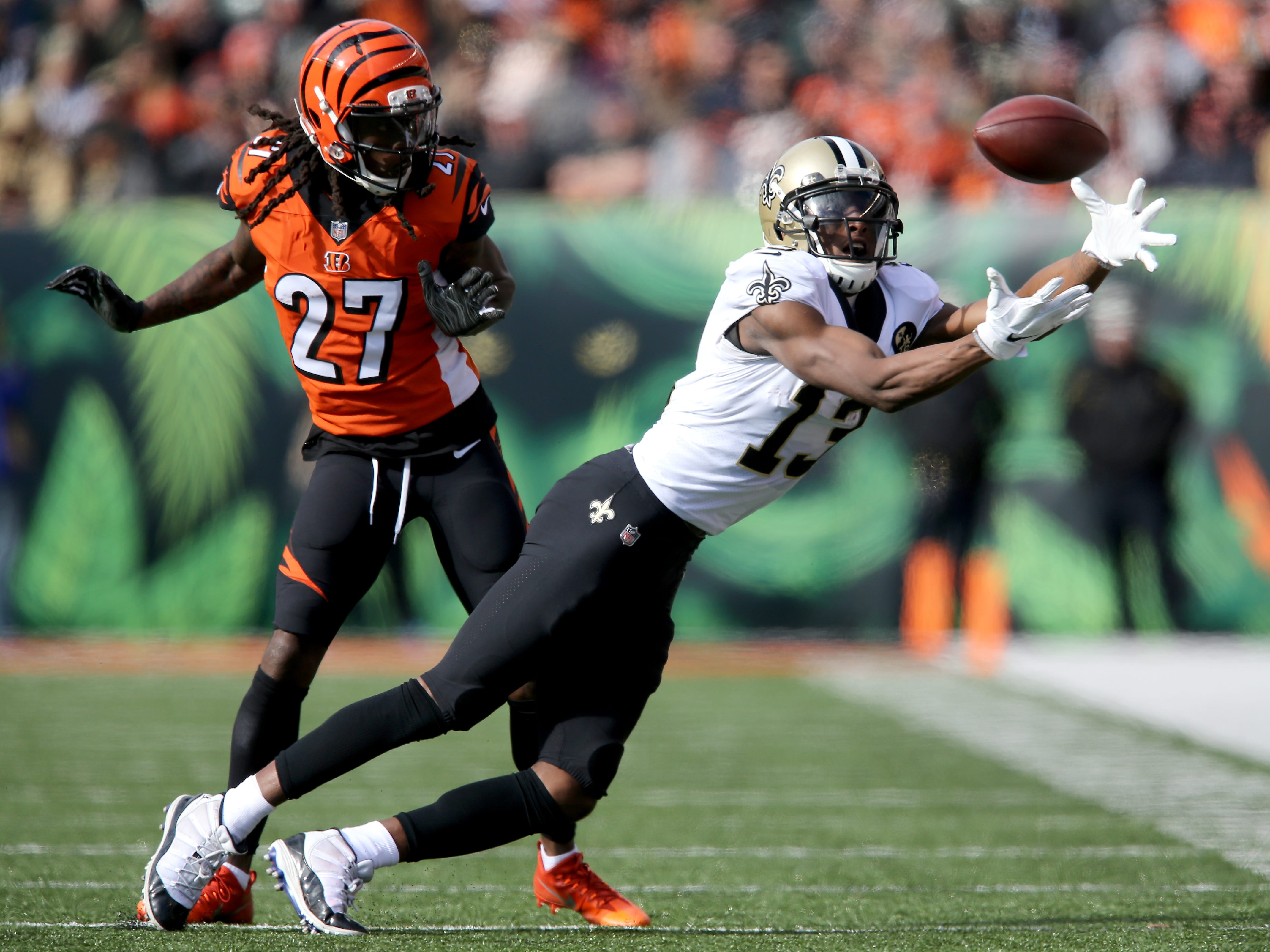 New Orleans Saints wide receiver Michael Thomas (13) reaches for a reception as Cincinnati Bengals cornerback Dre Kirkpatrick (27) is called for pass interference in the second quarter of a Week 10 NFL game between the New Orleans Saints and the Cincinnati Bengals, Sunday, Nov. 11, 2018, at Paul Brown Stadium in Cincinnati.