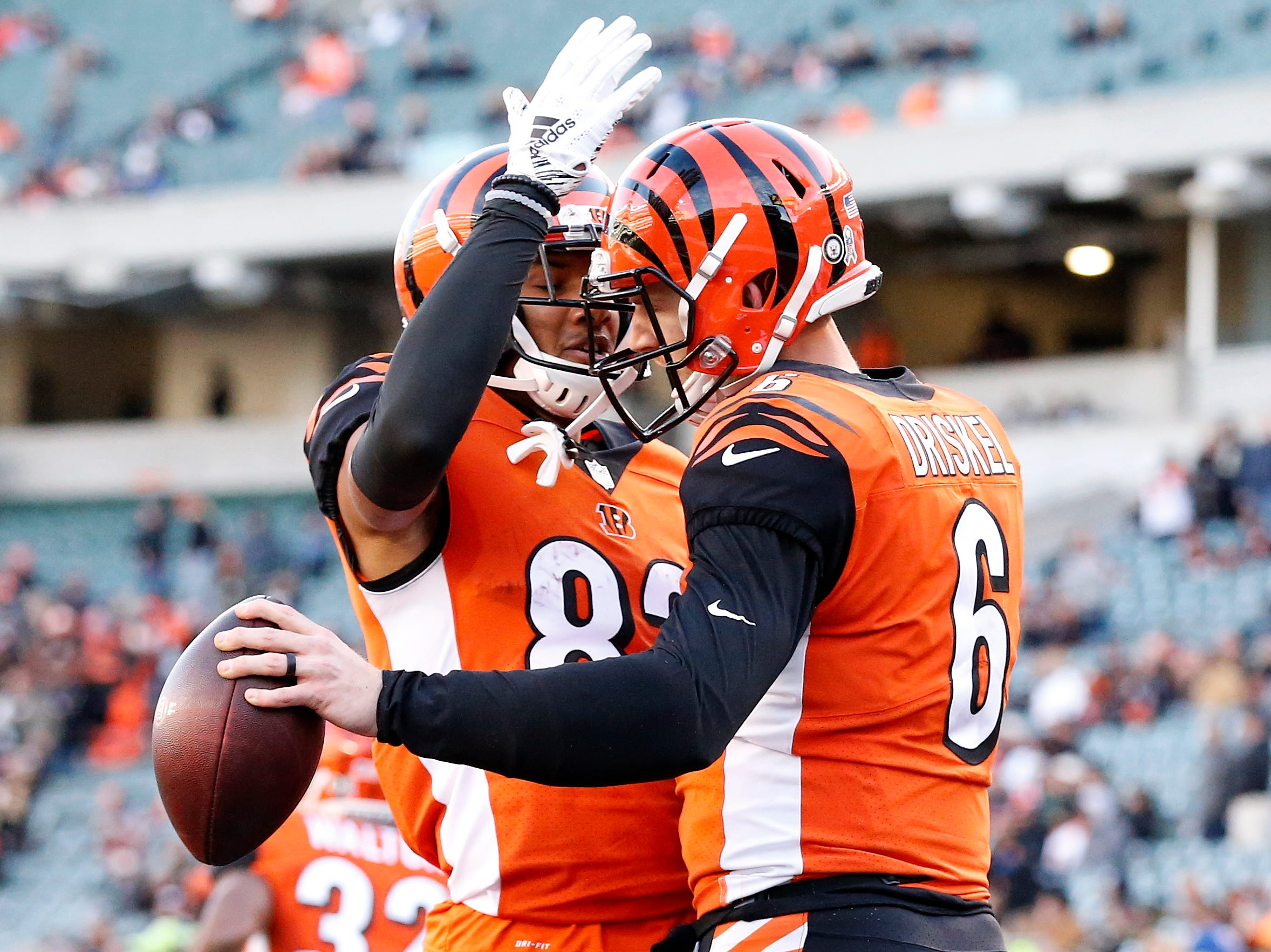 Cincinnati Bengals quarterback Jeff Driskel (6) and wide receiver Tyler Boyd (83) celebrate after Driskel's touchdown in the fourth quarter of the NFL Week 10 game between the Cincinnati Bengals and the New Orleans Saints at Paul Brown Stadium in downtown Cincinnati on Sunday, Nov. 11, 2018. The Saints beat the Bengals 51-14.