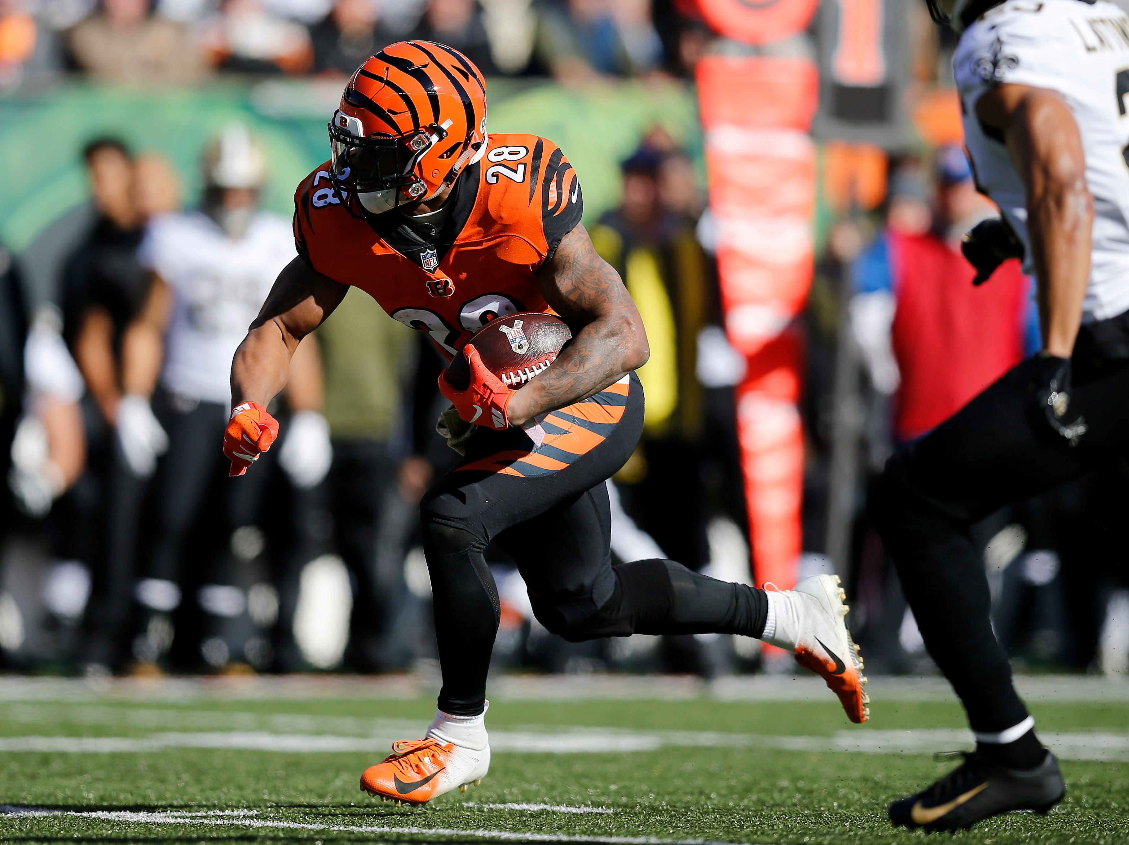 Cincinnati Bengals running back Joe Mixon (28) makes a carry for a first down in the first quarter of the NFL Week 10 game between the Cincinnati Bengals and the New Orleans Saints at Paul Brown Stadium in downtown Cincinnati on Sunday, Nov. 11, 2018. The Saints led 35-7 at halftime.