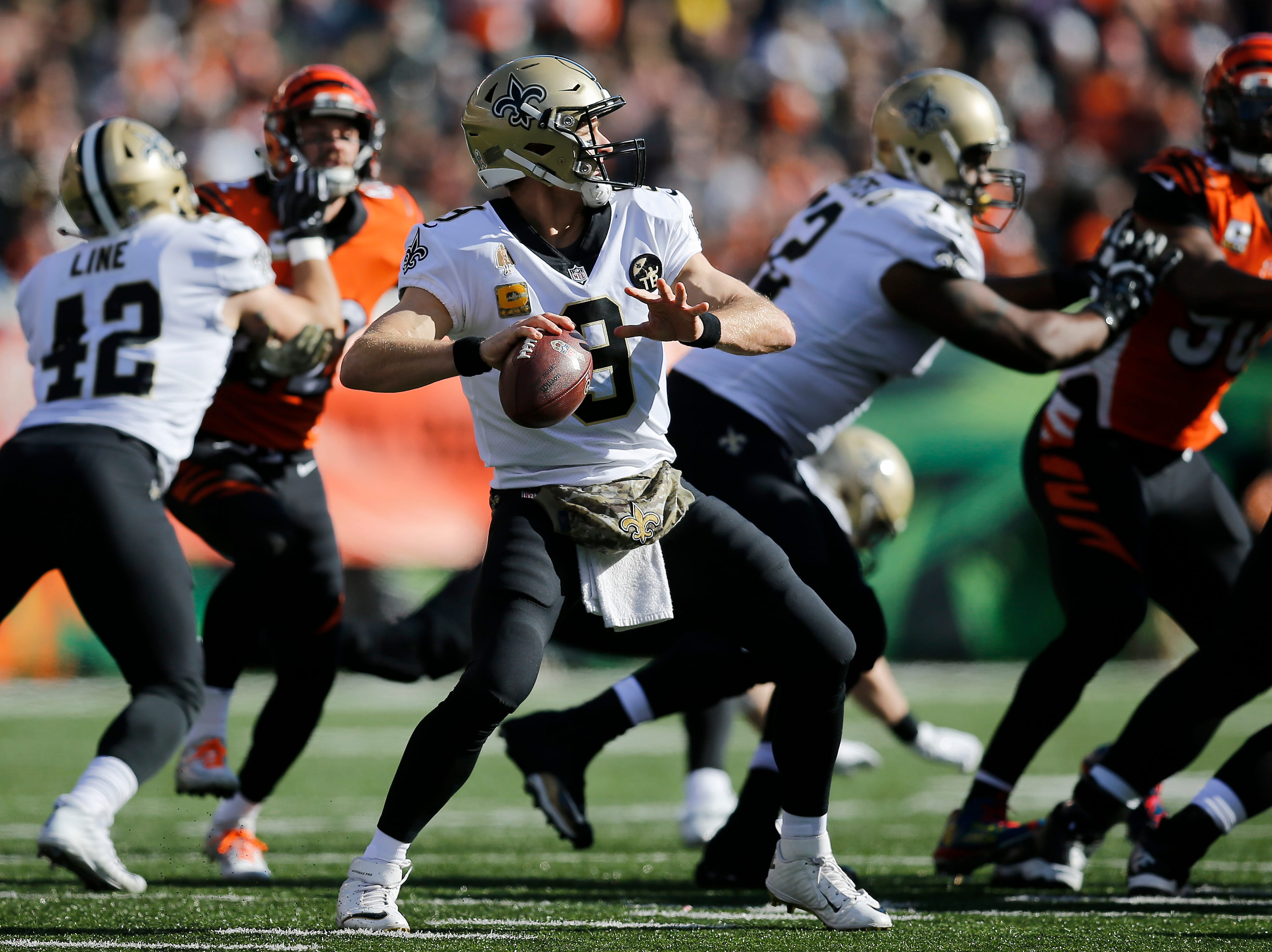 New Orleans Saints quarterback Drew Brees (9) drops back to throw a deep pass in the first quarter of the NFL Week 10 game between the Cincinnati Bengals and the New Orleans Saints at Paul Brown Stadium in downtown Cincinnati on Sunday, Nov. 11, 2018. The Saints led 35-7 at halftime.