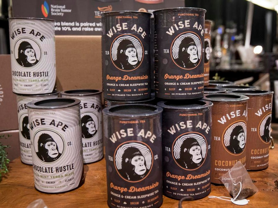 Tins of Wise Ape tea are stacked up for purchase during the Cincinnati Coffee Festival at Music Hall Saturday, November 10, 2018 in Cincinnati, Ohio. Wise Ape is based out of New Jersey.