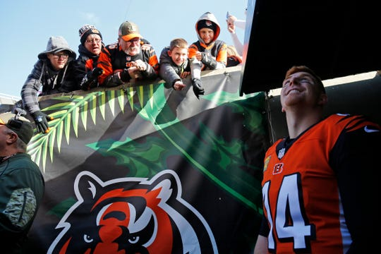 Fans call out to Cincinnati Bengals quarterback Andy Dalton (14) as he prepares to take the field for the first quarter of the NFL Week 10 game between the Cincinnati Bengals and the New Orleans Saints at Paul Brown Stadium in downtown Cincinnati on Sunday, Nov. 11, 2018. The Saints led 35-7 at halftime.