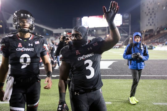 Cincinnati Bearcats running back Michael Warren II (3) and Cincinnati Bearcats quarterback Desmond Ridder (9) greet fans after the NCAA football game between Cincinnati Bearcats and South Florida Bulls on Saturday, Nov. 10, 2018, at Nippert Stadium in Cincinnati. Cincinnati Bearcats defeated South Florida Bulls 35-23.