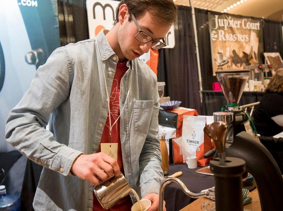 Austin Patterson of Tinker Techs makes a drink during the Cincinnati Coffee Festival at Music Hall Saturday, November 10, 2018 in Cincinnati, Ohio.