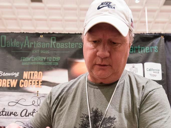 Joe Clark of Oakley Artisan Roasters makes a pour over during the Cincinnati Coffee Festival at Music Hall Saturday, November 10, 2018 in Cincinnati, Ohio.
