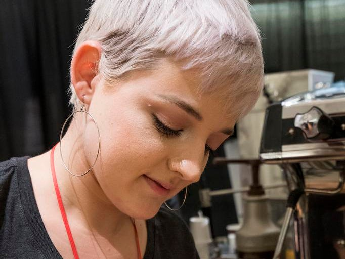 Holly Birrer of Urbana Cafe pours a drink during the Cincinnati Coffee Festival at Music Hall Saturday, November 10, 2018 in Cincinnati, Ohio.