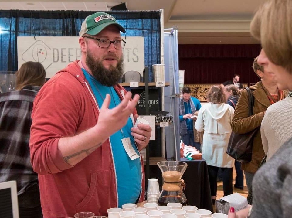 Matt Hoffman of Deeper Roots talks to guests at the Cincinnati Coffee Festival at Music Hall Saturday, November 10, 2018 in Cincinnati, Ohio.