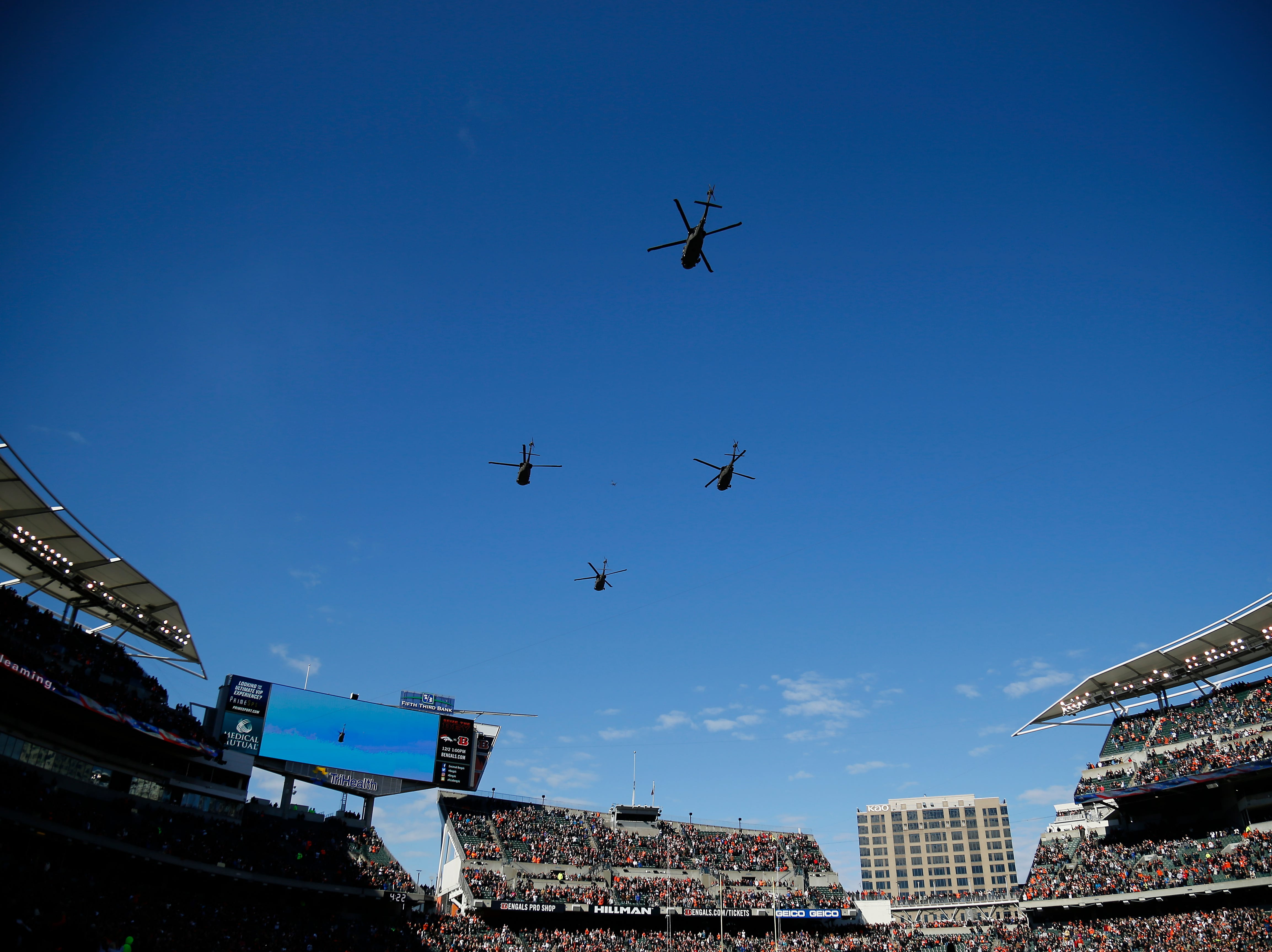 Four military helicopters fly over the stadium before the first quarter of the NFL Week 10 game between the Cincinnati Bengals and the New Orleans Saints at Paul Brown Stadium in downtown Cincinnati on Sunday, Nov. 11, 2018. The Saints led 35-7 at halftime.