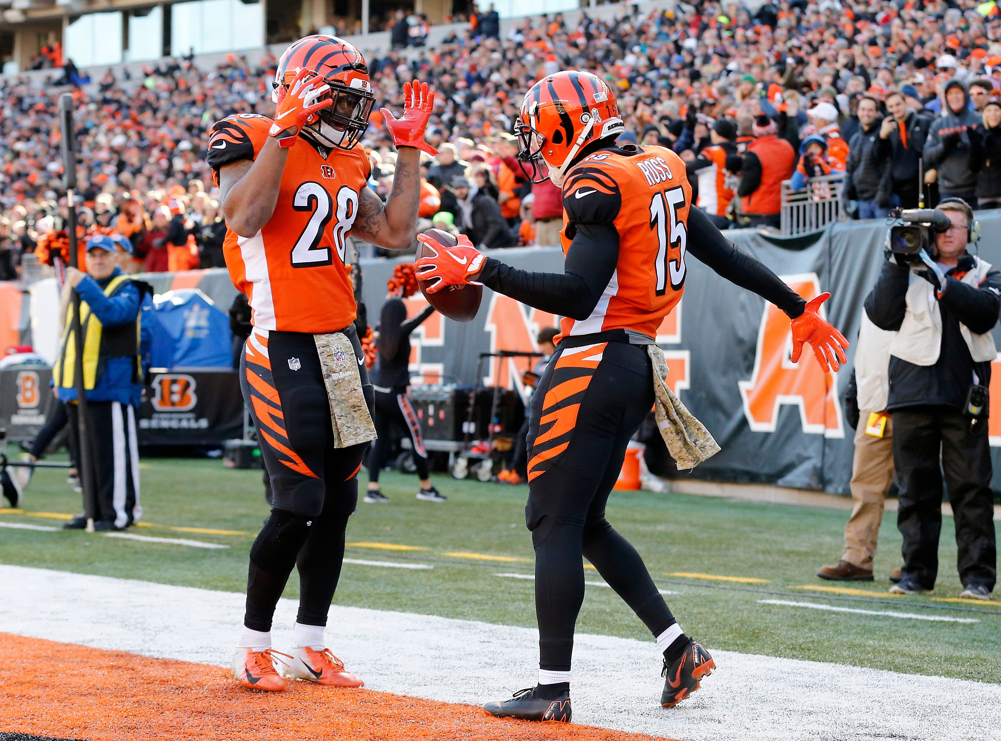 Cincinnati Bengals running back Joe Mixon (28) and wide receiver John Ross (15) dance after the Ross touchdown reception in the first quarter of the NFL Week 10 game between the Cincinnati Bengals and the New Orleans Saints at Paul Brown Stadium in downtown Cincinnati on Sunday, Nov. 11, 2018. The Saints led 35-7 at halftime.