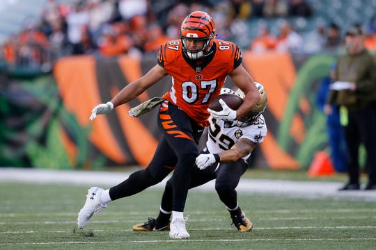 Cincinnati Bengals tight end C.J. Uzomah (87) breaks a tackle after a catch in the fourth quarter of the NFL Week 10 game between the Cincinnati Bengals and the New Orleans Saints at Paul Brown Stadium in downtown Cincinnati on Sunday, Nov. 11, 2018. The Saints beat the Bengals 51-14.