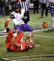 D J Ames (1) of CHCA breaks up a Madison pass at midfield at the Division V region semifinal, November 10, 2018.