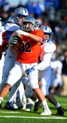 Somerville's Joseph Ciempola (32) gets tackled during the first half against Holmdel in a Central Group III semifinal on Saturday, Nov. 10, 2018.