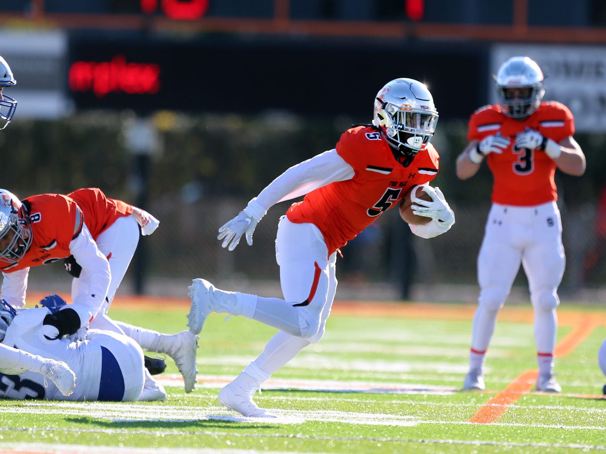 Somerville's Duke McDuffie (5) runs the ball against Holmdel during the first half of a Central Group III semifinal on Saturday, Nov. 10, 2018.