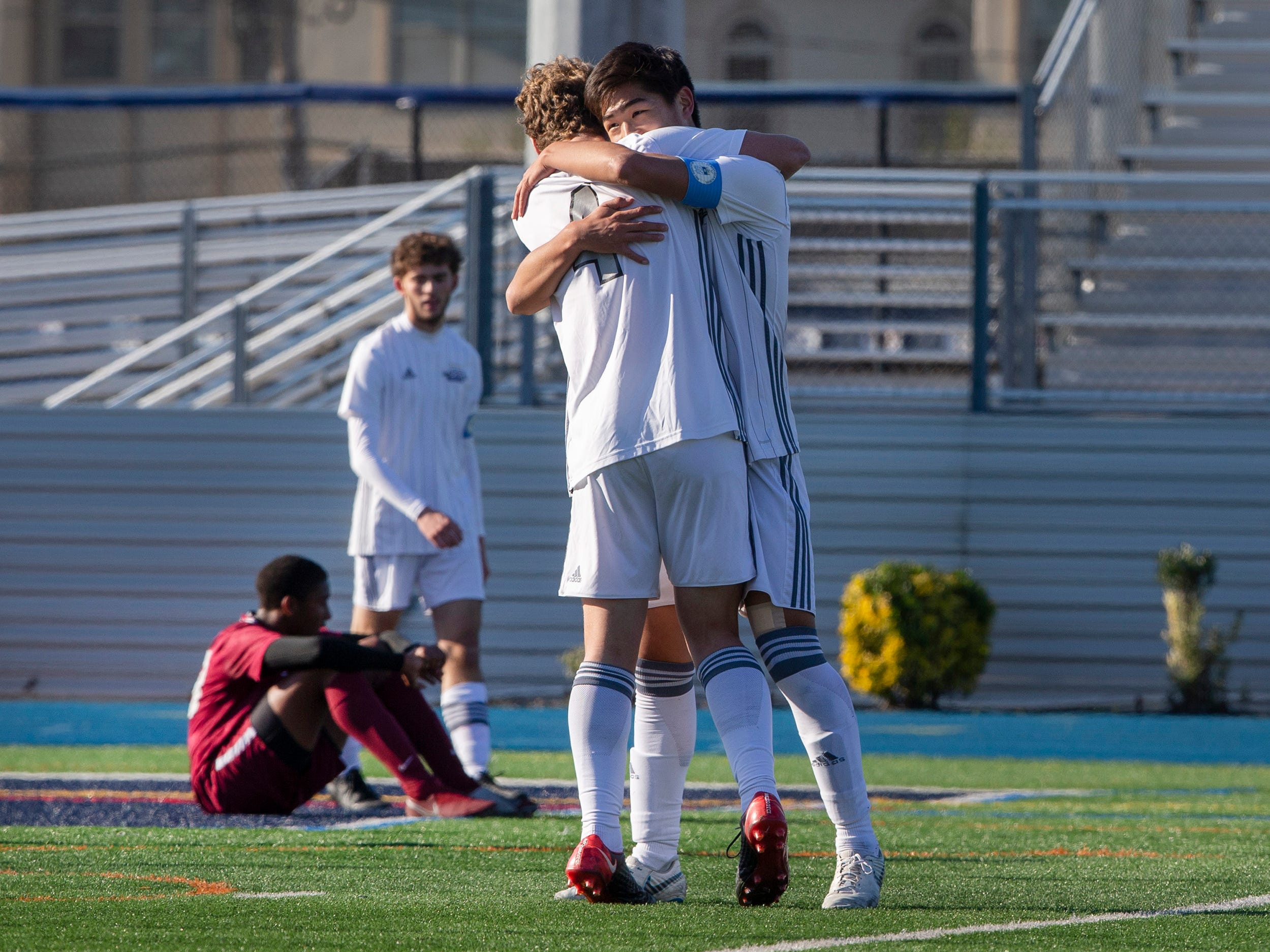 Gill-St Bernard's #11 Dan Shen hugs Alex Borto as time runs out and they celelbrate their State Championship win. Gill-St Bernards vs Rutgers Prep in NJSIAA Boys Non-public B State Soccer Final