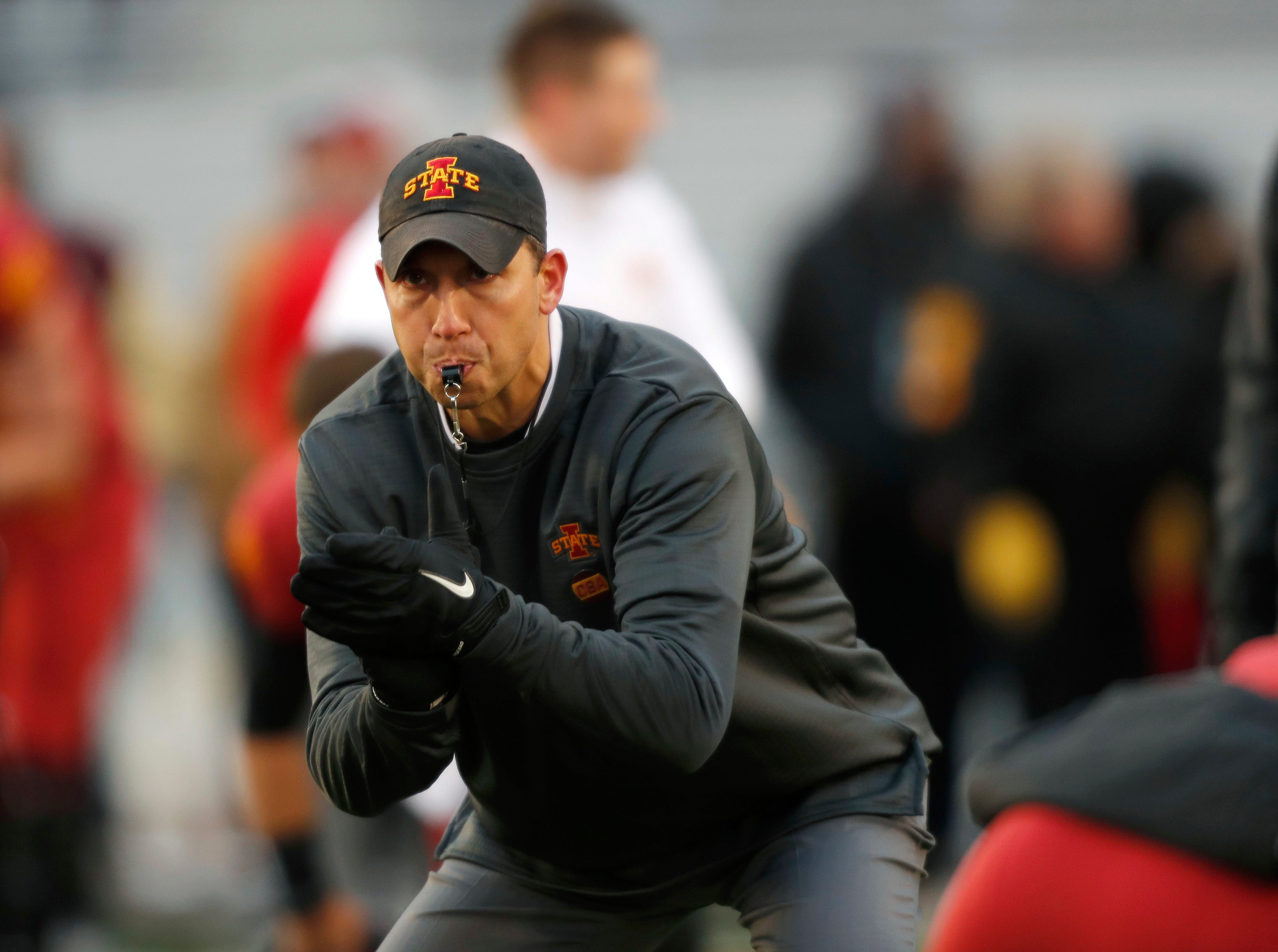 Iowa State head coach Matt Campbell directs his players during warmups before an NCAA college football game against Baylor, Saturday, Nov. 10, 2018, in Ames.