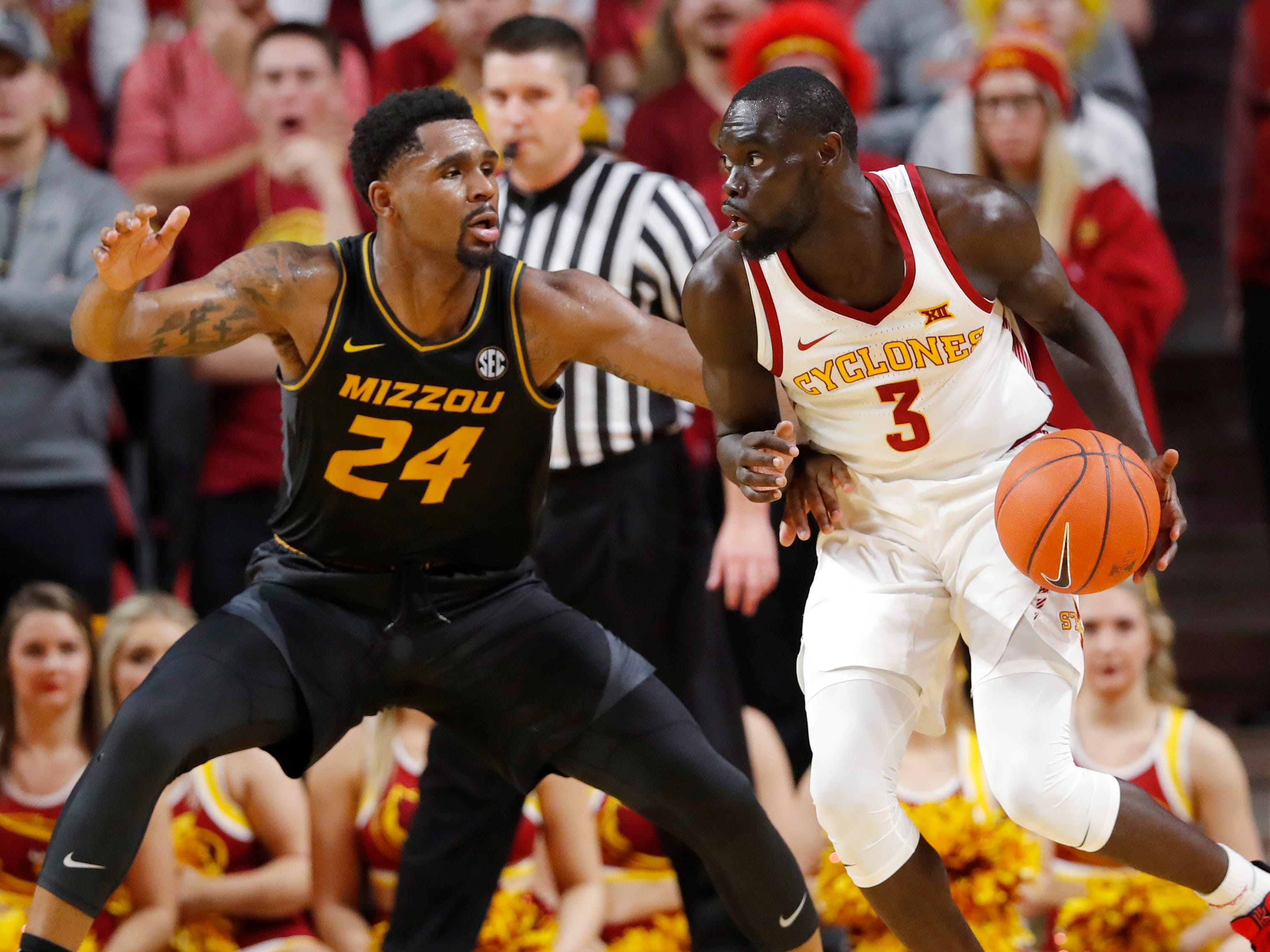 Iowa State guard Marial Shayok drives past Missouri forward Kevin Puryear, left, during the second half of an NCAA college basketball game, Friday, Nov. 9, 2018, in Ames, Iowa. Iowa State won 76-59.