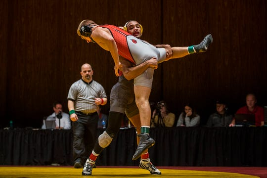 Iowa State's Marcus Coleman wrestles SIU-Edwardsville's Ryan Yarnell at 174 during a dual between the two schools on Sunday, Nov. 11, 2018, in CY Stephens Auditorium in Ames. Iowa State won the meet 37-3.