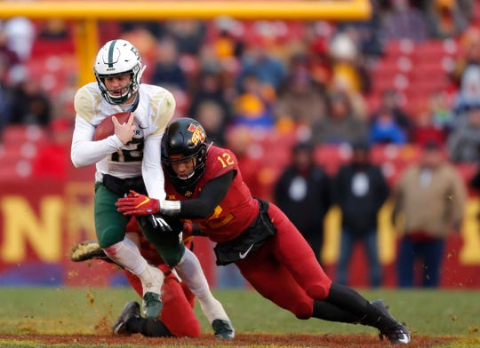 Baylor quarterback Charlie Brewer, left, runs the ball as he is tackled by Iowa State defensive back Greg Eisworth, right, during the first half of an NCAA college football game, Saturday, Nov. 10, 2018, in Ames. (AP Photo/Matthew Putney)