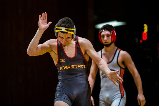 Iowa State's Austin Gomez celebrates after winning his match against SIU-Edwardsville's Jacob Blaha at 133 during a dual between the two schools on Sunday, Nov. 11, 2018, in CY Stephens Auditorium in Ames. Iowa State won the meet 37-3.