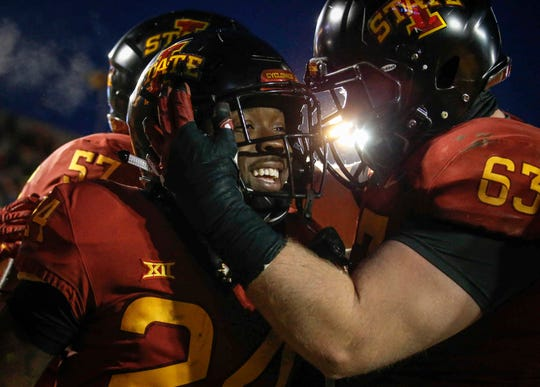 Iowa State running back Johnnie Lang, left, is hugged by guard Colin Newell after Lang ran into the end zone for a touchdown against Baylor at Jack Trice Stadium in Ames on Saturday, Nov. 10, 2018.