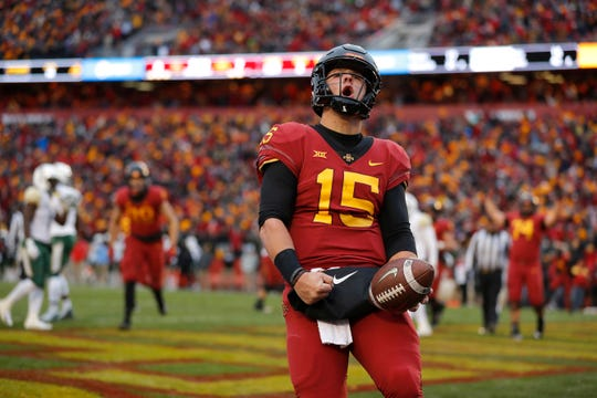 Iowa State quarterback Brock Purdy celebrates his touchdown run during the first half of an NCAA college football game against Baylot, Saturday, Nov. 10, 2018, in Ames.