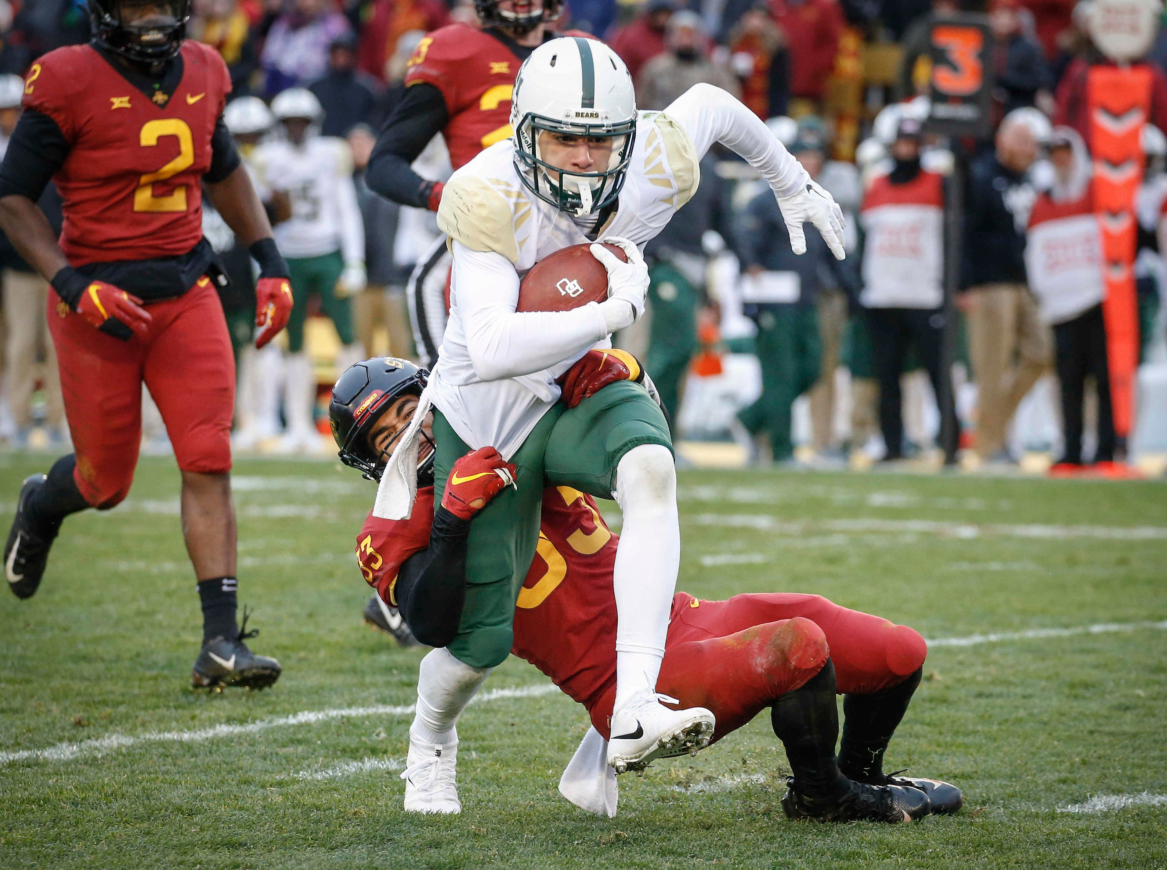 Baylor receiver Jalen Hurd is caught by Iowa State Braxton Lewis in the first quarter at Jack Trice Stadium in Ames on Saturday, Nov. 10, 2018.